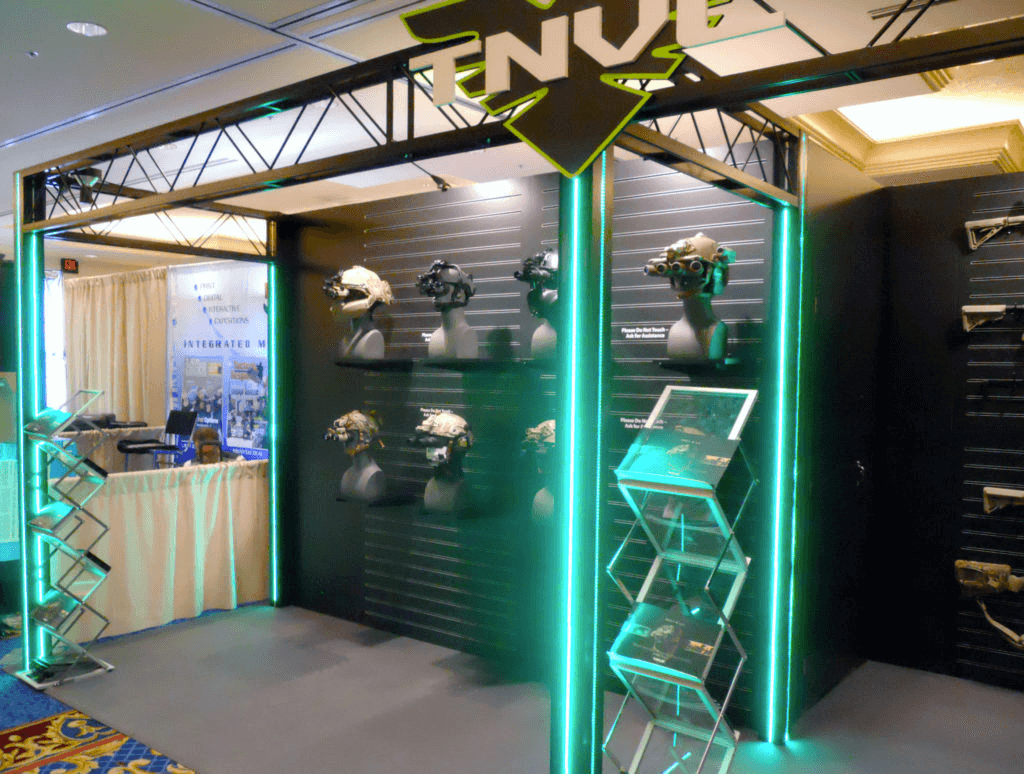 A branded showroom display featuring tactical equipment and neon lighting
